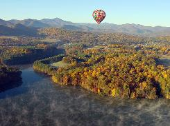 A view of Asheville's fall foliage from a hot air balloon ride. The mountains that surround Asheville, N.C., are called the Blue Ridge. But in the fall, they might as well be called the orange, red and yellow.