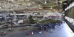 "A Boeing B-17F Flying Fortress that is undergoing restoration is parked in front of the massive doors of the Boeing Co.'s historic ""Plant 2,"" in Seattle. After giving birth to some of the world's most significant aircraft, the outdated facility is scheduled to be torn down this fall."