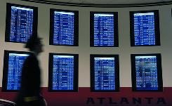 Signs at Hartsfield-Jackson Atlanta International Airport alert fliers to schedule changes.