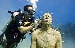 British sculptor Jason de Caires Taylor plants fire coral in a sculpture called Man on Fire, which was installed in the museum last year.