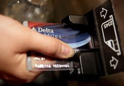 The only credit cards that earn miles in airline accounts are the cards co-branded with the airline.