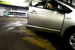 On the go: Jennifer Becker Mouhcine gets into a Toyota Prius that she rented from Enterprise in Chicago. Customers rated Enterprise No. 1 among its peers.