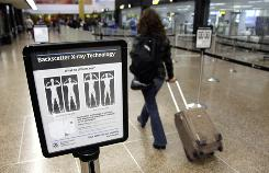 "A sign informs travelers about the use of full-body scanners at Seattle-Tacoma International Airport. TSA chief John Pistole said there is the ""potential"" for delays at airports Wednesday if people boycott the scanners."