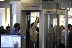 A passenger goes through a body scanner during TSA screening at Ronald Reagan Washington National Airport Wednesday.