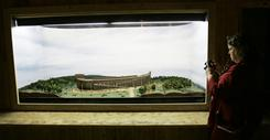 A visitor at the Creation Museum in Petersburg, Ky., takes pictures of a display on Noah's Ark. A full-scale replica of the ark could be built in the city of Williamstown.