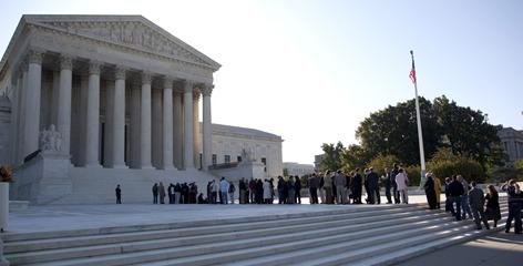 People line up outside the Supreme Court in Washington, in October 2009. In May, the court closed the main entrance and began steering people through new security checks. 