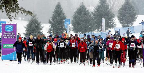 Cross-country skiers take off from the start of the Canadian Ski Marathon in Gatineau, Quebec, in Feb., 2008.