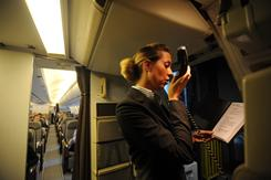 In flight manager Samantha Gatherer tells passengers to turn off their cellphones before a flight in May 2008. While in-flight entertainment is permitted, the issue of concern to the FAA is the unknown emissions of electronic devices such as cellphones and tablets.