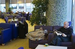 Airport lounges, such as the British Airways Terrace Lounge at the Seattle airport, allow for more comfortable travel, with cushy chairs, and access to power outlets, snacks and beverages.