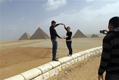 German tourists pose for pictures at the Giza pyramids on the outskirts of Cairo.
