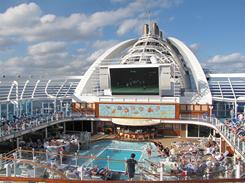 "A trademark feature of the Crown Princess is ""Movies Under the Stars,"" an outdoor, 300-square foot screen that shows free movies, sporting events and other specials."