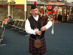 TSA administrative officer Daniel Meek, when not at work at Milwaukee's General Mitchell Airport, plays bagpipes at events ranging from funerals to law enforcement ceremonies.