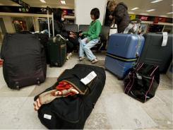Looking to home: Mexican nationals outbound from Japan arrive in Mexico City on Friday. Alarm about Japan's nuclear crisis has prompted departures.