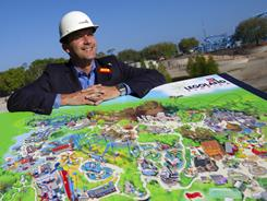 General manager Adrian Jones displays a map of Legoland Florida during a preview tour at the park in Winter Haven, Fla. The new theme park is scheduled to open south of Orlando in October.