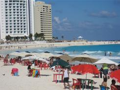 Vacationers enjoy Cancun's famous aquamarine waters and white sands in the Hotel Zone  a line of resorts that stretches more than 10 miles.