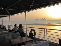 Passengers on the 40-cabin MS Sabena Farida watch a sunrise on the Nile River in Upper Egypt. Many tour companies are offering discounted cruises to lure back wary tourists.