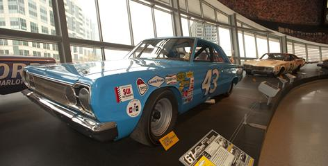 Richard Petty's 1966 Plymouth Belvedere is among the notable displays at the NASCAR Hall of Fame in Charlotte.