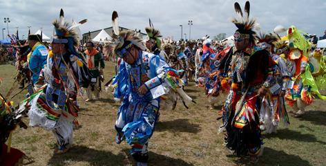 Lumbee men make a grand entry during the Dance of the Spring Moon. Powwow events honor Lumbee heritage, as well as tribes from the American West, Canada and Central America.