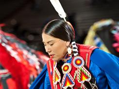 A dancer adorned with a lone eagle feather competes at the Gathering of Nations powwow in Albuquerque, NM.