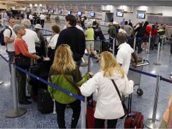 Passengers stand in line at the American Airlines counter as they try to rebook their flights at Miami International Airport on Feb. 1.