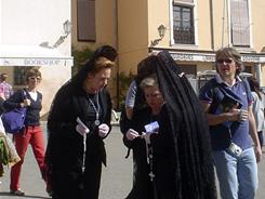 Penitent women wear mantilla scarves over peinetas during Holy Week in Granada, Spain. Some women in Andalusia wear traditional black dress and walk between the floats in the Semana Santa, or Holy Week, parades.