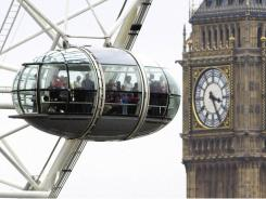 "A car on the London Eye, with ""Big Ben"" in the background, in Britain's capital."