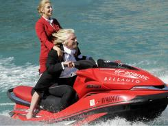 Richard Branson rides a Jet Ski with a Virgin Atlantic flight attendant at a 2010 publicity event in Las Vegas.