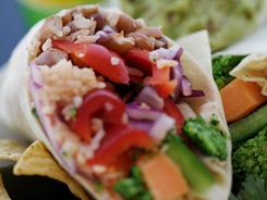 "Anna's Taqueria, a mini Boston chain, offers a ""super-sized"" burrito for an extra 90 cents."