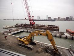 Workers construct the new port for shipping, and cruise ships in Detroit. The complex will include a public viewing area, customs station to process cruise ships passengers and postal service.