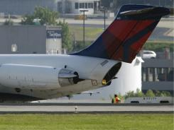 A Delta jet sits at Hartsfield-Jackson Atlanta International Airport after a troubled landing Saturday.