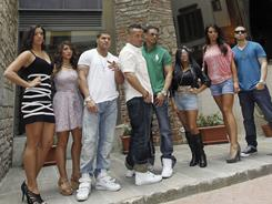 """Members of MTV reality show """"Jersey Shore"""" from left; Jenni Farley, Nicole """"Deena"""" Cortese, Ronnie Ortiz Magro, Mike Sorrentino, Pauly D Del Vecchio, Nicole Polizzi, Sammi Gianicola, Vinny Guadagnino, pose for photographers outside the Tower of Pagliazza, in Florence, Italy."""