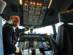 Pilot Juergen Rabs sits in the cockpit of the new airplane Airbus A380 of the German airline Lufthansa after the test landing at the Franz-Josef-Strauss airport in Munich on June 2, 2010.