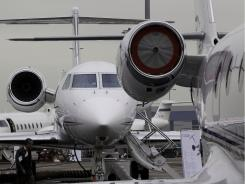Business jet planes are displayed in March at the Asian Aerospace International Expo and Congress in Hong Kong.
