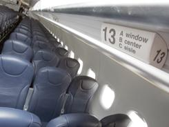 In a three-person row, who is entitled to the middle armrests?