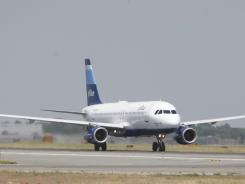 A JetBlue airplane takes off from John F. Kennedy International Airport in New York.