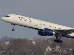 A Delta Airlines jet takes off at Boston's Logan International Airport on Jan. 20.