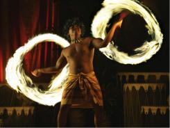 In Hawaii:  A fire dancer at Kona Village's  Hawaiian luau, where locals and visitors take in the music, food, and dance of Hawaii and Polynesia.