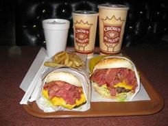 The regular Crown Burger is topped with Thousand Island dressing, lettuce, tomato, onions, cheese and pastrami.
