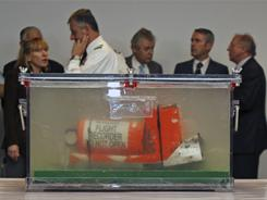 One of the two flight recorders of the Air France flight 447, that crashed in 2009, is displayed to reporters during a press conference at the French investigators' headquarters near Paris, in May.