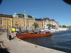 Stockholm's downtown harbour of Nybroviken, where sightseeing boats and water taxis line the dock.