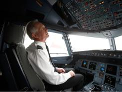 """Miracle on the Hudson"" pilot Chesley ""Sully"" Sullenberger in a US Airways jet in October 2009."