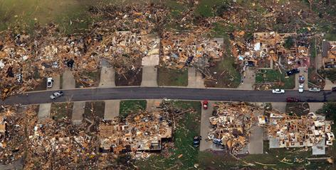 Damage is seen one day after a tornado tore through Joplin killing more than 150 people and destroying much in its path.
