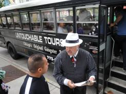 "Craig ""South Side"" Alton, owner of Untouchable Tours, right, picks up customers for a morning gangster tour in Chicago that hits all the sites of the city's famous Mob hits."
