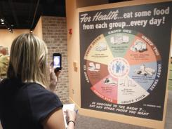 Exhibit curators looked back at the history of farming, food processing, nutrition guidelines and the effects of military food and school lunches.