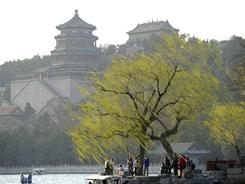 People walk by the Kunming Lake at the Summer Palace in Beijing on April 4. China requires a visa that costs $140 per person for entry to the country and you must have six months remaining on your passport before expiration.
