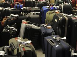 Luggage waits at a  baggage claim at O'Hare Airport, in Chicago in this file photo.