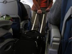 Passengers board a Delta Airlines flight.  seats seat overhead luggage bags flight attendant [Via MerlinFTP Drop]