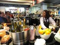 Bartender Katrina Arnold serves up drinks at America Eats Tavern.