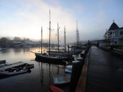 A list of seaside escapes wouldn't be right without an option in coastal Maine. Here, a quiet Camden Harbor shrouded in fog.