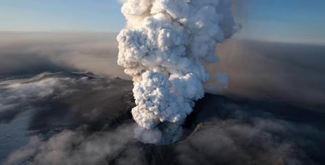 Ash and plumes of grit hang over Iceland's Eyjafjallajokull volcano on April 17, 2010.